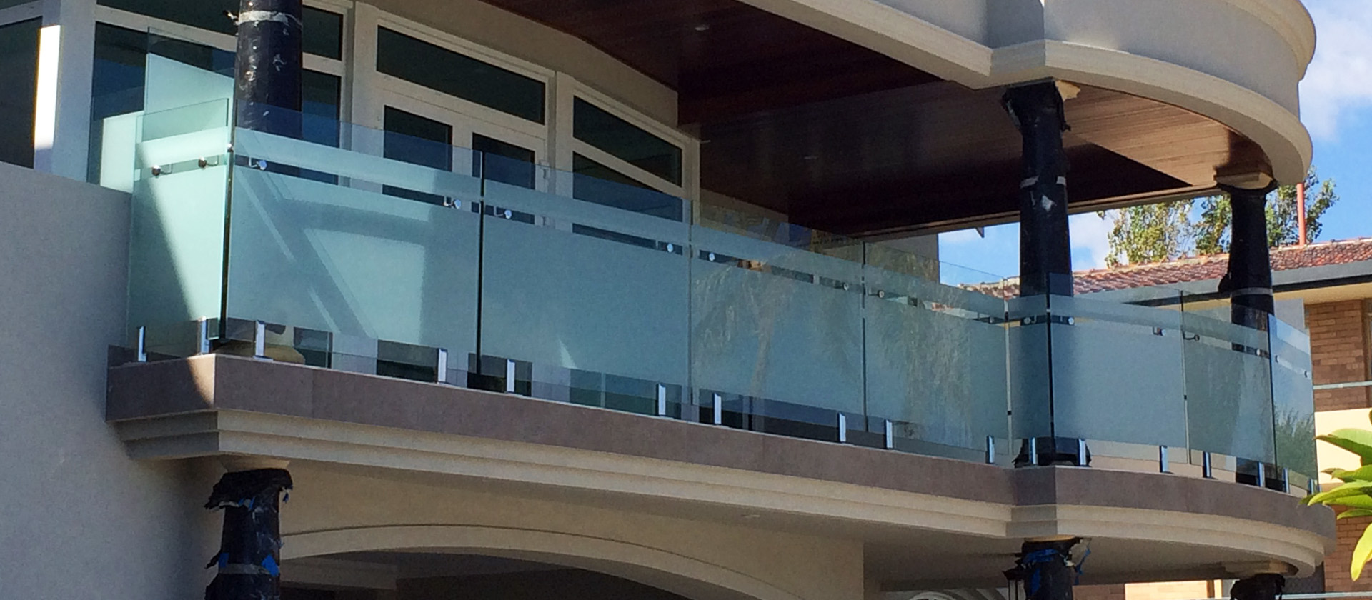 Frosted glass balustrade provides privacy