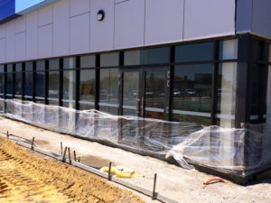 Window manifestation strips on commercial buildings
