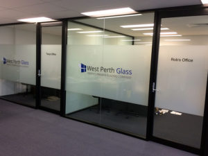 Internal frosted windows in office with signage
